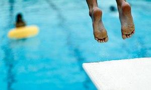 A-boy-jumps-off-a-diving--007